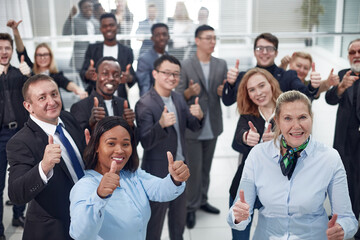 group of diverse co-workers giving a thumbs up .