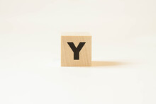 Y Letter On Wooden Background With White Background