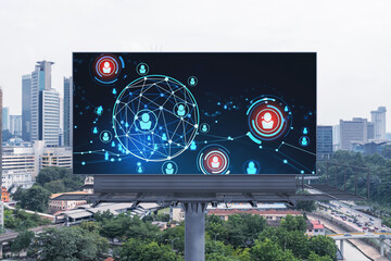 Glowing Social media icons on road billboard over panoramic city view of Kuala Lumpur, Malaysia, Asia. The concept of networking and establishing new connections between people and businesses in KL.