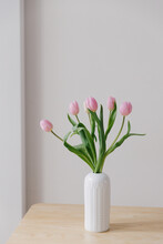 Pink Tulips In A White Vintage Vase In A European Scandinavian Styled Interior.