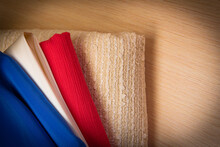 Three Solid Fabrics In Blue And Red Shades Of Color On A Light Background,copy Space,vignetting