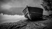 Abandoned Boat Moored On Lakeshore