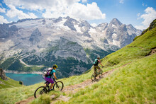 Man And Woman Mountain Biking In The Dolomites, Val Gardena, South Tyrol, Italy
