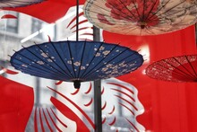Close-up Of Umbrellas Hanging Outdoors