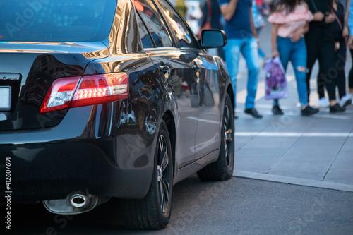 Obraz na plátně car with people in crosswalk