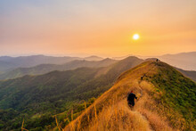 Traveler Man Hiking Enjoying In The Mountains With Backpack At Khao Chang Puak Mountain Thailand