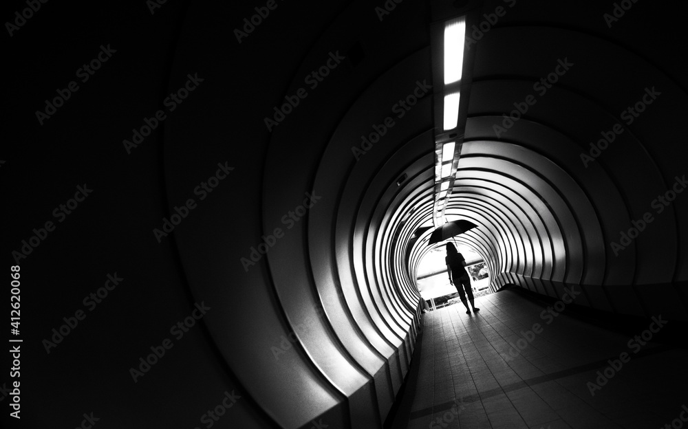 Fototapeta Rear View Of Woman Standing In Subway