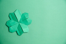 St. Patrick's Day Card: Four-leaf Paper Clover On Green Background