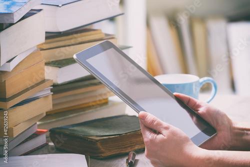 Man holding a modern ebook reader
