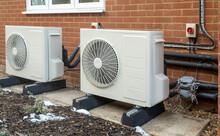 Air Source Heat Pump Installation On A Modern House