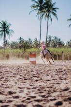 Little Girl Running Barrels On Horse Back