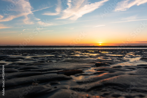 Fotografie, Obraz Beautiful Sunset at the Beach in the Netherlands.