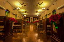 Beautiful Interior View Of Little Country Church With Empty Wooden Pews.