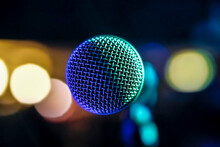 Directly Above Shot Of Microphone Against Defocused Lights