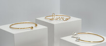 Love Word Shape And Pearls Bracelets On White Boxes