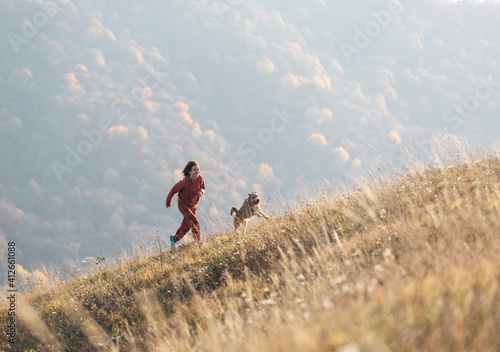 Canvas Print cheerful woman walks with her dog