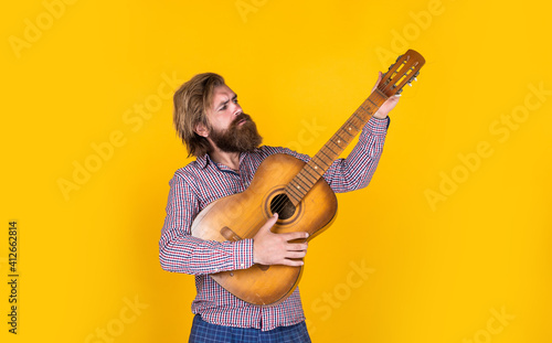 Fotografie, Obraz hipster with long hair and moustache guitarist