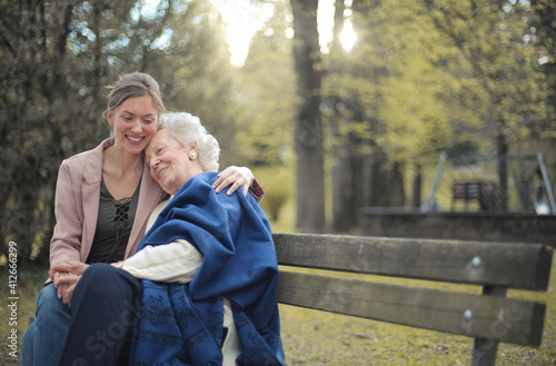 Obraz na plátne grandson with grandmother huddled in a park