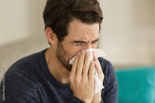 Fototapeta man blowing his nose obraz