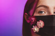 Leinwandbild Motiv Teenage girl with black face mask with flowers