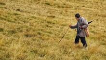 Senior Man Walking On Land