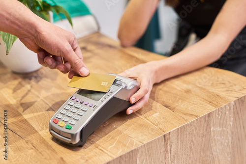 Cropped Hand Paying With Credit Card In Store