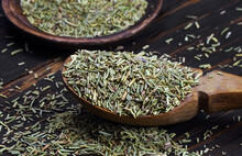 Dry Rosemary In A Wooden Spoon On The Table