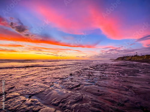 Fototapeta Scenic View Of Sea Against Dramatic Sky During Sunset obraz