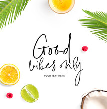 "Creative Layout Made Of  Quote ""Good Vibes Only"".  Tropical Flat Lay. Food Concept. Coconut, Lemon, Raspberry, Lime And Juice On The White Background."