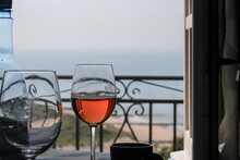 Close-up Of A Glas Of Wine  On Table Against Sea During Sunset