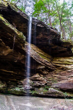 A Waterfall Over A Big Overhanging Rock Roof Of Layered Sandstone In A Long Tall Column, Sipsey Wilderness, Alabama