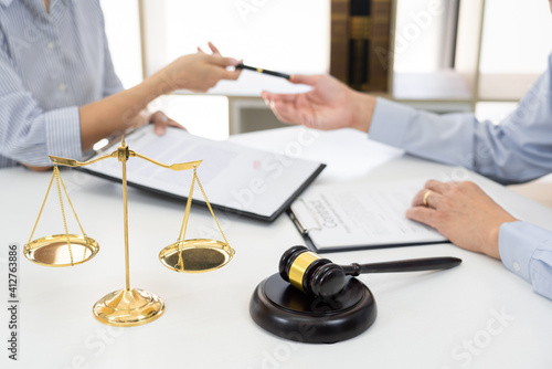 Professional Secretary lawyer working at his office signing contract Consultatio Wallpaper Mural