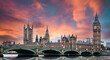canvas print picture - Stunning sunset over London's southern part with Westminster Abbey, Big Ben, Houses of Parliament, Westminster bridge and the Thames river flowing in the foreground.
