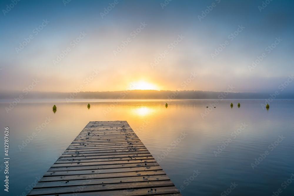 Fototapeta Pier Over Sea Against Sky During Sunset
