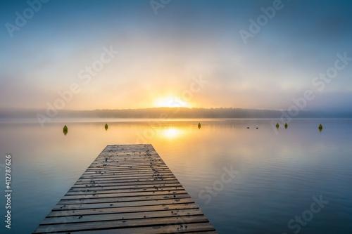 Fototapeta Pier Over Sea Against Sky During Sunset obraz