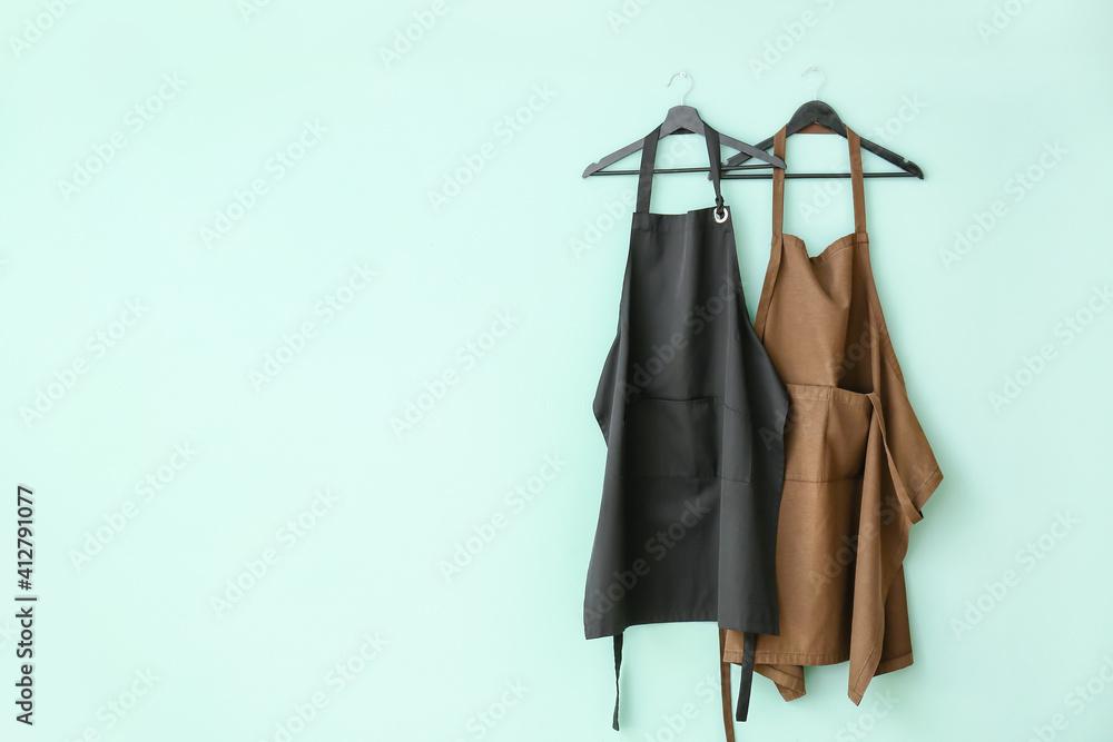 Fototapeta Clean aprons on color background