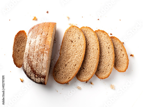 Fototapeta Sliced loaf of bread is isolated on white background