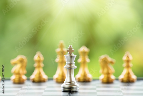 Photo Close-up Of Chess Pieces On Chess Board Against Plants