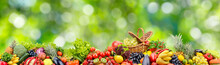Panoramic Collection Fresh Fruits And Vegetables On Blurred Green