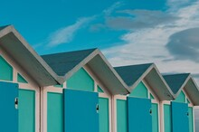 A Series Of Turquoise Beach Sheds With Blue Wooden Doors In A Winter Day (Pesaro, Italy, Europe)