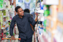 Young Black Man Shopping In A Supermarket
