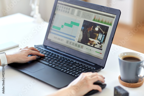 Fotografie, Obraz technology, post production and vlog concept - close up of woman working in vide