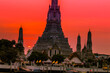 Blurred abstract background of the pagoda scenery of Wat Arun on the Chao Phraya River in Bangkok of Thailand, the silhouette, the light hitting the sculpture, has a kind of artistic beauty.