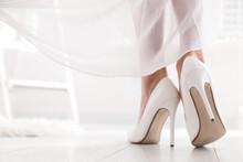 Young Bride In Beautiful Wedding Shoes Walking Indoors, Closeup