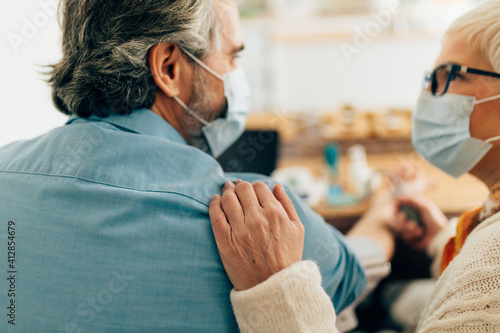Obraz na plátně Close up of a senior couple consulting with their doctor online on their tablet
