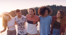 Happy Young Group Of Friends Stroll At The Beach By The Lake Jump Adventure In The Woods Teen Life Adventure Concept Slow Motion Shot On Red Epic W