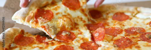 Pizza with cheese and ham. Food delivery city concept © H_Ko