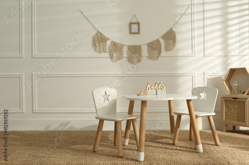 Fototapeta Modern child room interior with stylish furniture and accessories