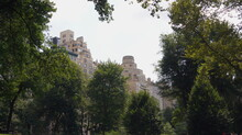 Rooftops As Seen From Central Park Trees
