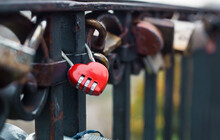 Red Love Door Lock On The Bridge. Selective Focus